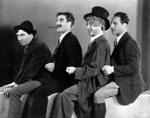 Four of the five Marx brothers, from left, Chico, Groucho, Harpo and Zeppo, pose in 1930.  (AP Photo)